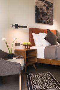 A bed or beds in a room at Akana Boutique Hotel