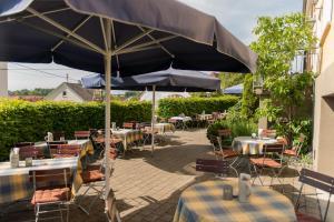 A restaurant or other place to eat at Brauerei und Gasthof zum Engel