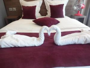 Cama o camas de una habitación en Hotel la Perle Montparnasse