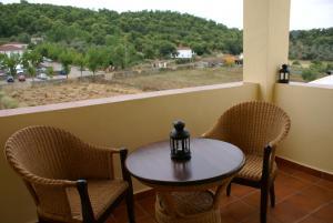 Un balcón o terraza de Hotel Sierra Luz