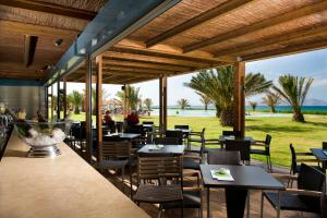 A restaurant or other place to eat at Astir Odysseus Kos Resort and Spa