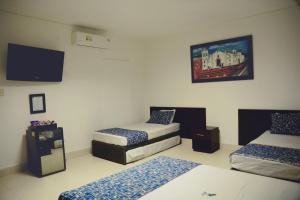 Cama o camas de una habitación en Hotel Medellin