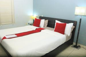 A bed or beds in a room at The Crib Lifestyle Hotel
