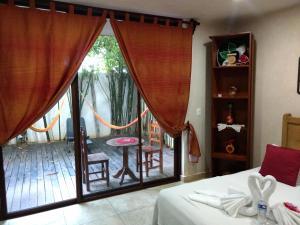 Кровать или кровати в номере Maya Vacanze Playa Natural