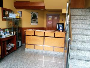 The lobby or reception area at Hotel Carbayon