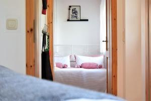 Ein Bett oder Betten in einem Zimmer der Unterkunft Apartments Das Wünsch Ich Mir