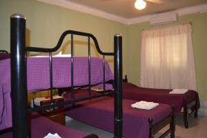 Una cama o camas cuchetas en una habitación  de Hospedaje Las Termas