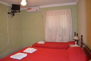 Una cama o camas en una habitación de Hospedaje Las Termas