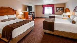A bed or beds in a room at Best Western Bidarka Inn