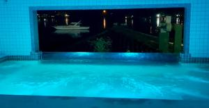 The swimming pool at or near Flat Angra Paradise