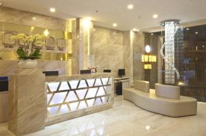 The lobby or reception area at New Sun Hotel