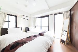 Ein Bett oder Betten in einem Zimmer der Unterkunft Gion Minami House