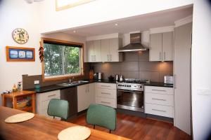 A kitchen or kitchenette at Unawatuna House @ Cape Woolamai