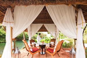 A restaurant or other place to eat at Taj Bekal Resort & Spa, Kerala