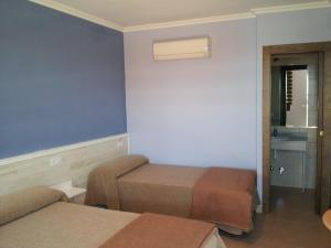 Cama o camas de una habitación en Tarik