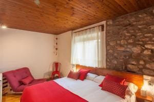 Llit o llits en una habitació de Hotel Cal rei de Talló