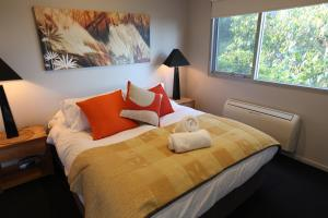 A bed or beds in a room at Lorne Luxury