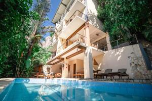 The swimming pool at or near Boutique Hotel Gávea Tropical