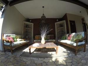 A seating area at Boutique Hotel Gávea Tropical