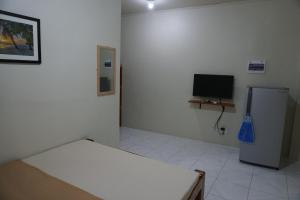 A television and/or entertainment center at Alimpay Foresters Apartment