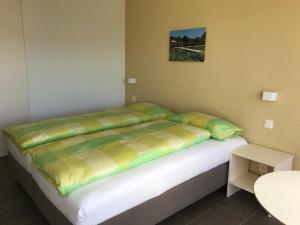 Ein Bett oder Betten in einem Zimmer der Unterkunft Bed & Breakfast Oasee