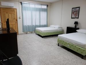 A bed or beds in a room at Hotel El Dorado