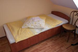 A bed or beds in a room at Zajazd Skorpion Rzeniszów