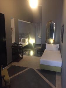 Un ou plusieurs lits dans un hébergement de l'établissement Riad Palais Bahia Fes