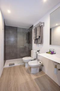 Een badkamer bij Apartamentos Hg Cristian Sur