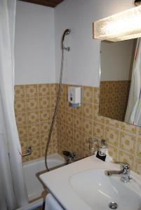 A bathroom at Hotel Restaurant Rustica