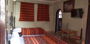 A bed or beds in a room at Hotel Wissam