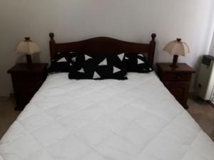 Una cama o camas en una habitación de Las Cañitas de Monte
