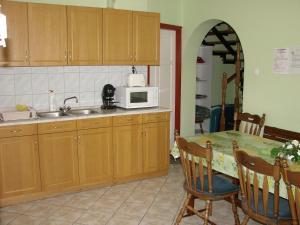 A kitchen or kitchenette at Benkő Vendégház