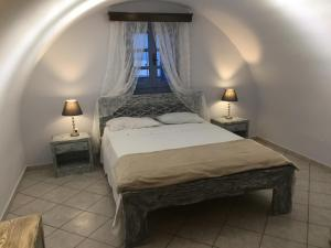 A bed or beds in a room at Alisaxni Resort