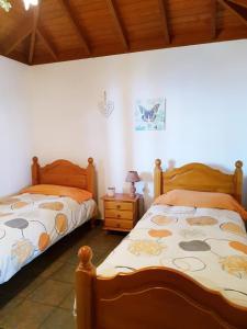 Een bed of bedden in een kamer bij Casa Óscar