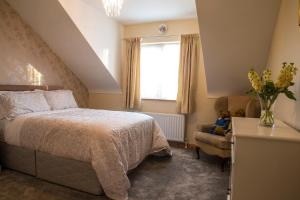 A bed or beds in a room at Kesh Country Manor B&B