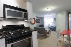 A kitchen or kitchenette at Charming 2BD in Hip Neighborhood - 3 Blks to Metro