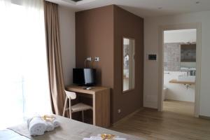 TV o dispositivi per l'intrattenimento presso Musmelia Rooms - Affittacamere