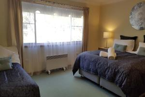 A bed or beds in a room at Telopea