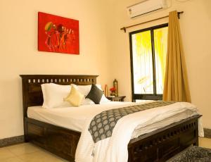 A bed or beds in a room at MeghBrishti Bari