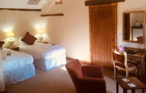A bed or beds in a room at Slapton Manor