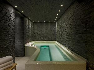 The swimming pool at or near Le Faucigny - Hotel de Charme