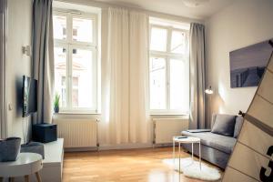 Ein Sitzbereich in der Unterkunft Schwerin City Apartment