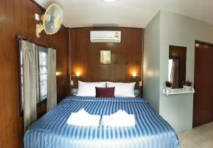A bed or beds in a room at BeauBo Beach