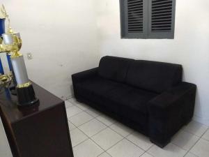 A seating area at Casa em Cajazeiras com Garagem