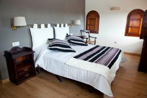 Cama o camas de una habitación en Hotel Cardenal Ram