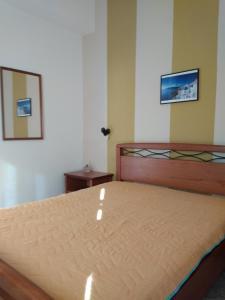 Säng eller sängar i ett rum på Costareli