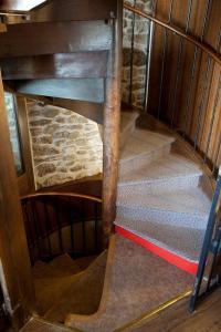 Ein Etagenbett oder Etagenbetten in einem Zimmer der Unterkunft Hôtel la Croix Blanche