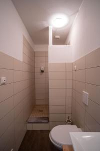 Ein Badezimmer in der Unterkunft Apartments Wolkentor