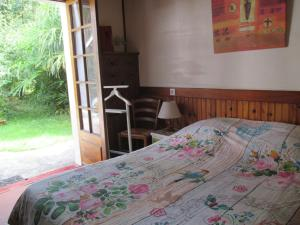 A bed or beds in a room at Gîte Habas